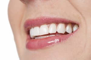 4334946-female-with-toothy-smile-close-up